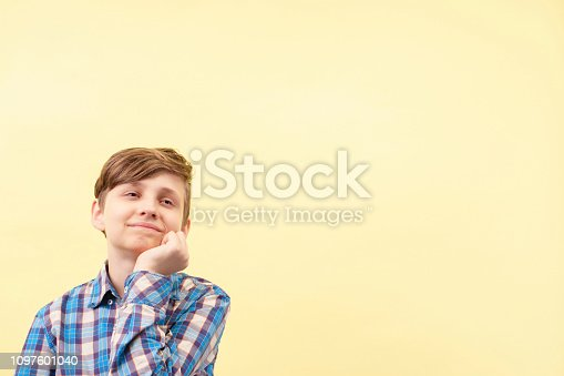 istock lacking concentration. inattentive, dreamy boy 1097601040