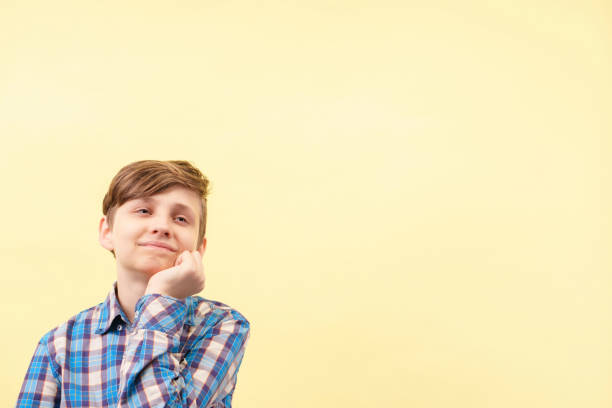 lacking concentration. inattentive, dreamy boy stock photo