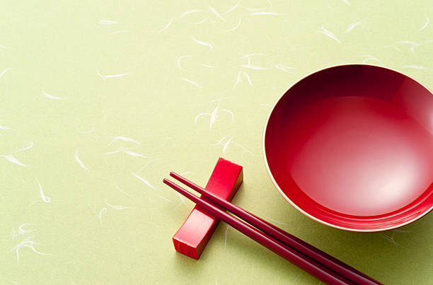 Lacquered bowl with chopsticks on Japanese paper (Washi) Lacquered bowl with chopsticks on Japanese paper (Washi) lacquered stock pictures, royalty-free photos & images