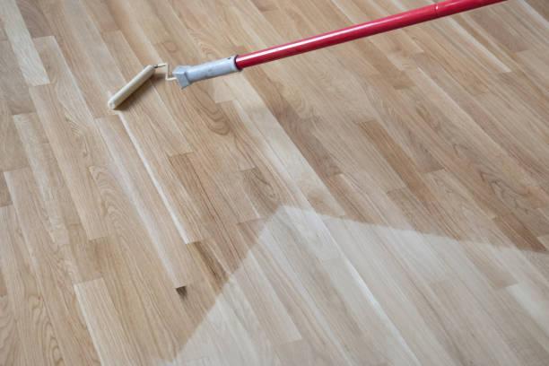 Lacquering Varnishing Parquet Floor stock photo