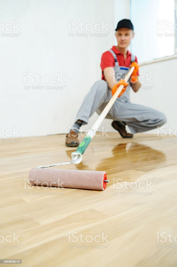 Lacquering wood floors. stock photo