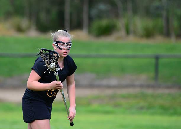 dziewczynka gry w lacrosse - lacrosse zdjęcia i obrazy z banku zdjęć