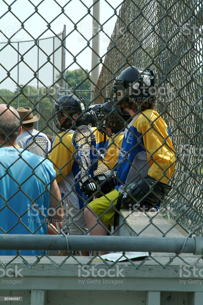 Lacrosse players on the bench royalty-free stock photo