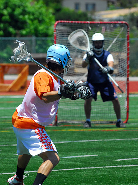 Lacrosse shooter aiming for goal stock photo