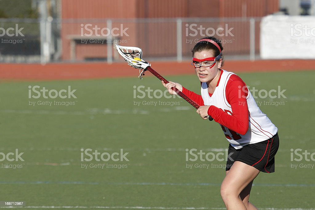 a lacrosse player gets ready to shoot