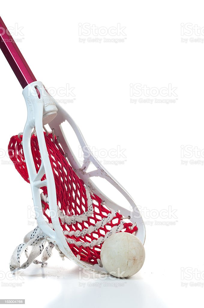 Lacrosse stick with ball leaning up on white background royalty-free stock photo