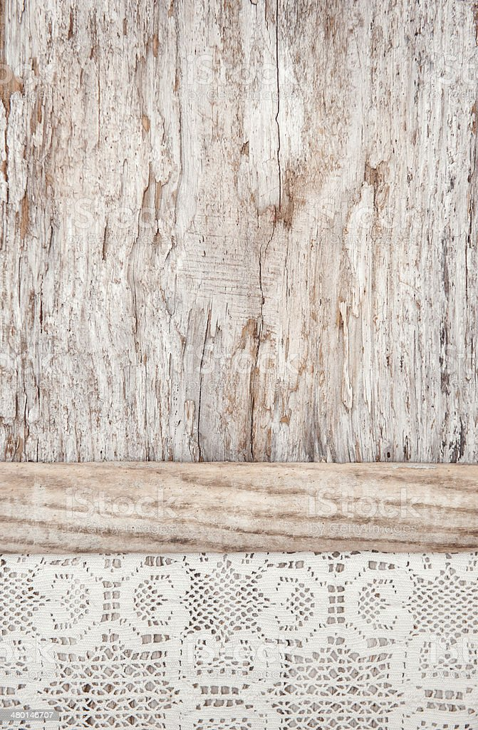 Lacy fabric on the old wooden background stock photo