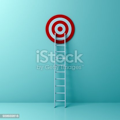 938669816 istock photo Ladder and goal target the business idea concept on light green pastel color wall background with shadow and reflection 938669816