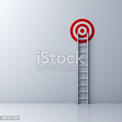 istock Ladder and the red target on white wall background 931227282