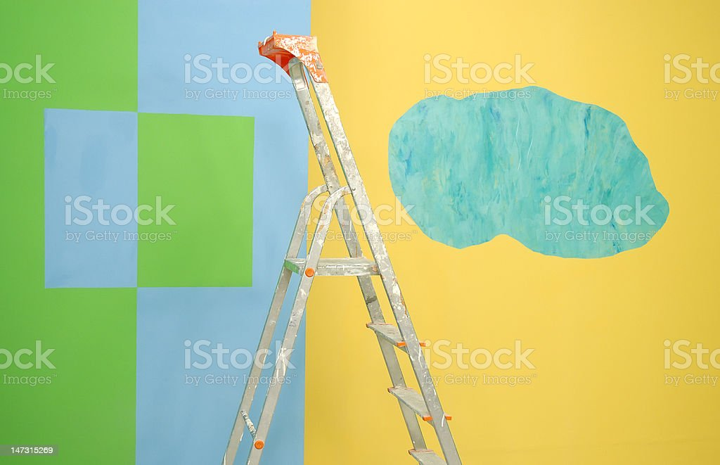 ladder by green and yellow painted walls royalty-free stock photo
