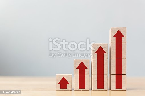 513121118 istock photo Ladder career path for business growth success process concept.Wood block stacking as step stair with arrow up 1142945247