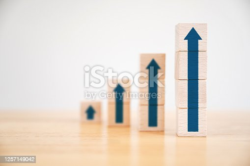 Ladder career path for business growth success process concept.Wood block stacking as step stair with arrow up
