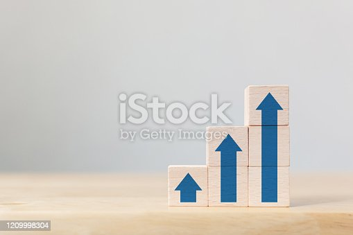 Ladder career path for business growth success process concept.Wooden block stacking as step stair with arrow up