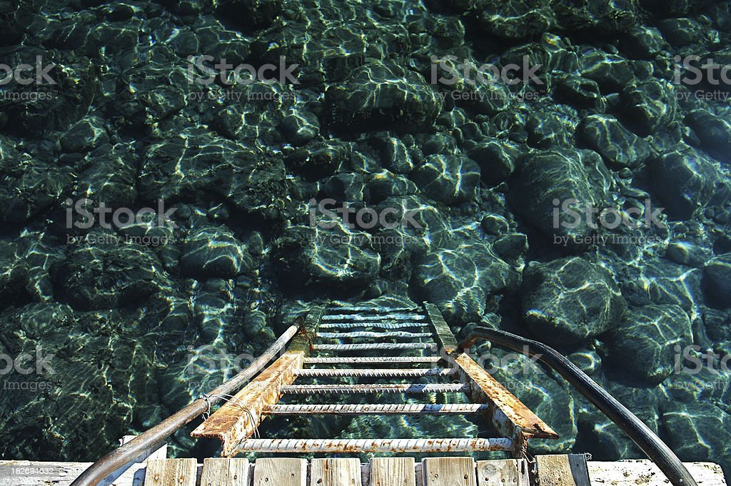 Ladder from Dock into Ocean royalty-free stock photo