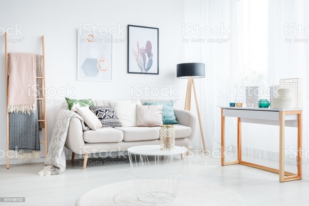 Ladder in bohemian living room stock photo