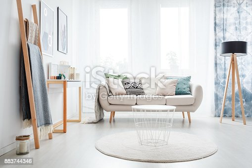 istock Ladder in bright living room 883744346