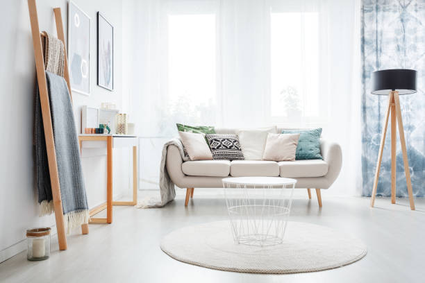 Ladder in bright living room stock photo