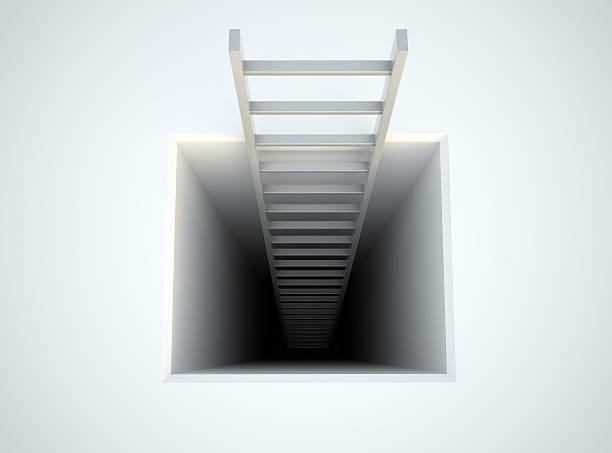 ladder leading from underground stock photo