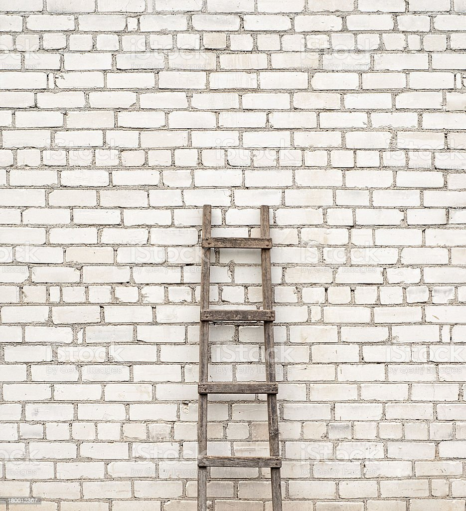 ladder near the brick wall background royalty-free stock photo