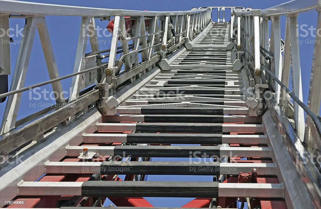 ladder of firefighters during an emergency to save the citizens royalty-free stock photo