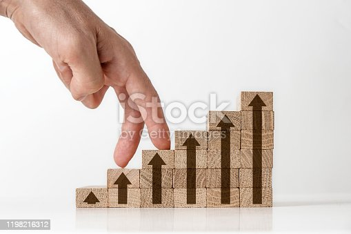 Fingers climbing the ladder of success. Growth concept on the toy wooden blocks, isolated on the white background.