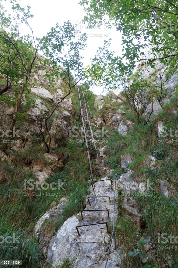 Ladder of Via ferrata near Riva del Garda, Italy stock photo