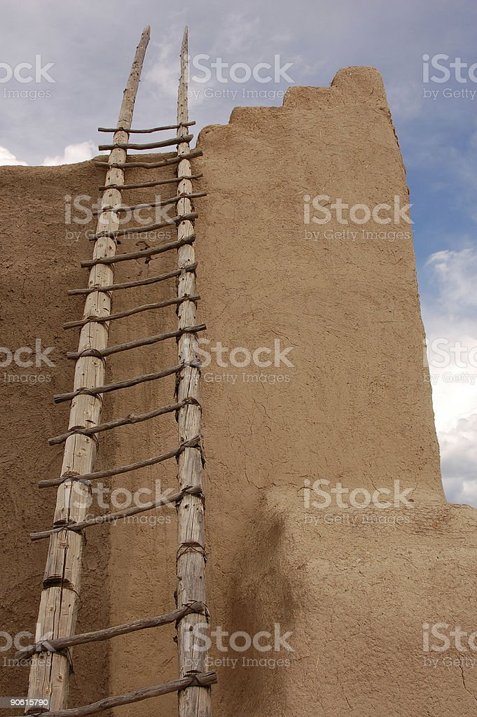 Ladder on Adobe Wall royalty-free stock photo