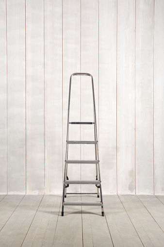 Ladder on Wood Background