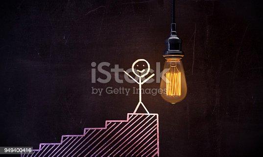 1127097479istockphoto Ladder To Success On Blackboard 949400416