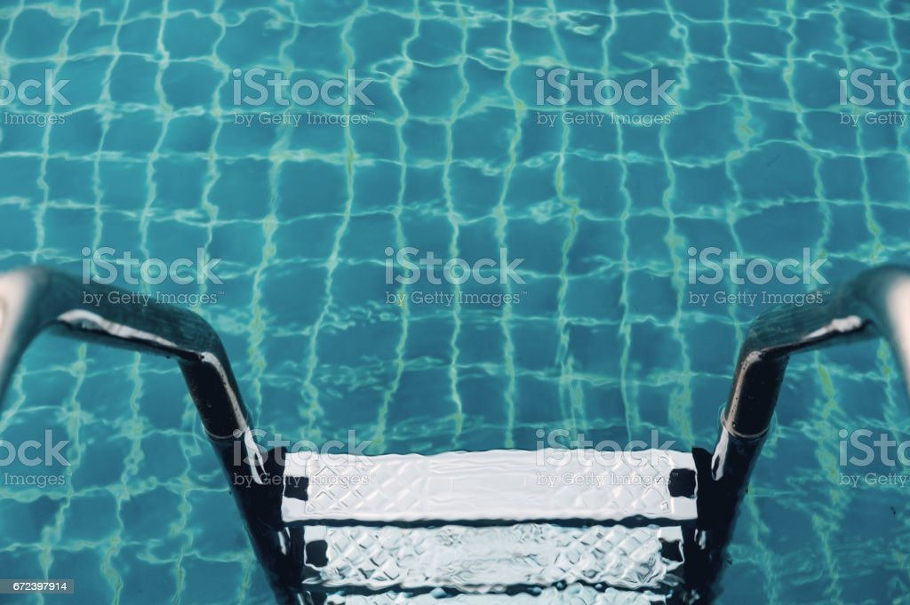 Ladders in swimming pool stock photo