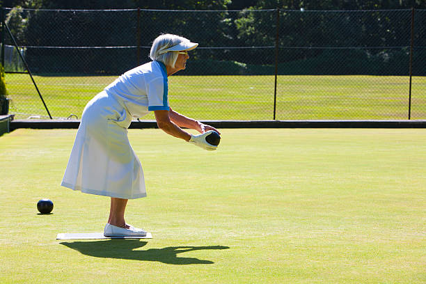 Ladie lawn bowling in bright sunshine stock photo