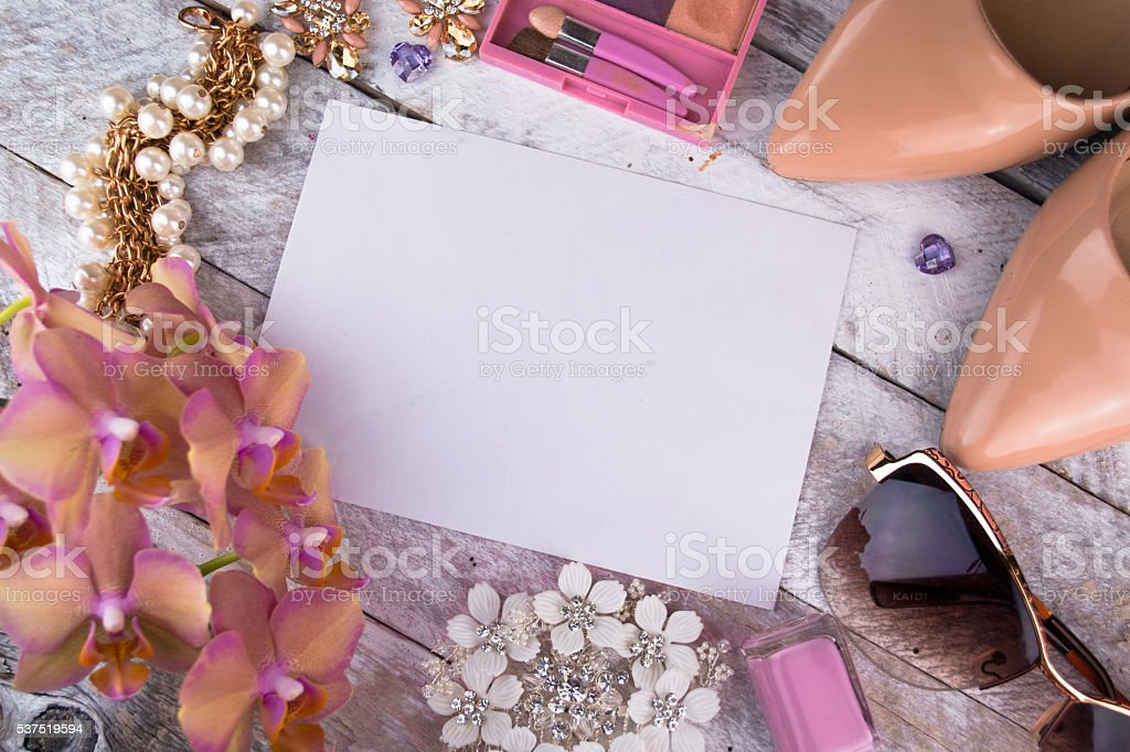 Ladies background - shoes, lipstick, nail polish, earrings stock photo