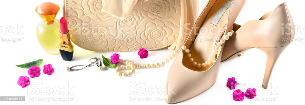 Ladies bag, shoes, jewelry, cosmetics and perfumes isolated on white...