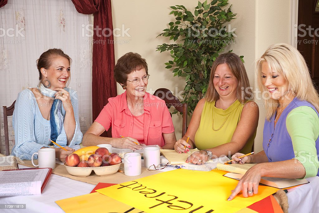 Ladies Bible study group planning a retreat at home royalty-free stock photo
