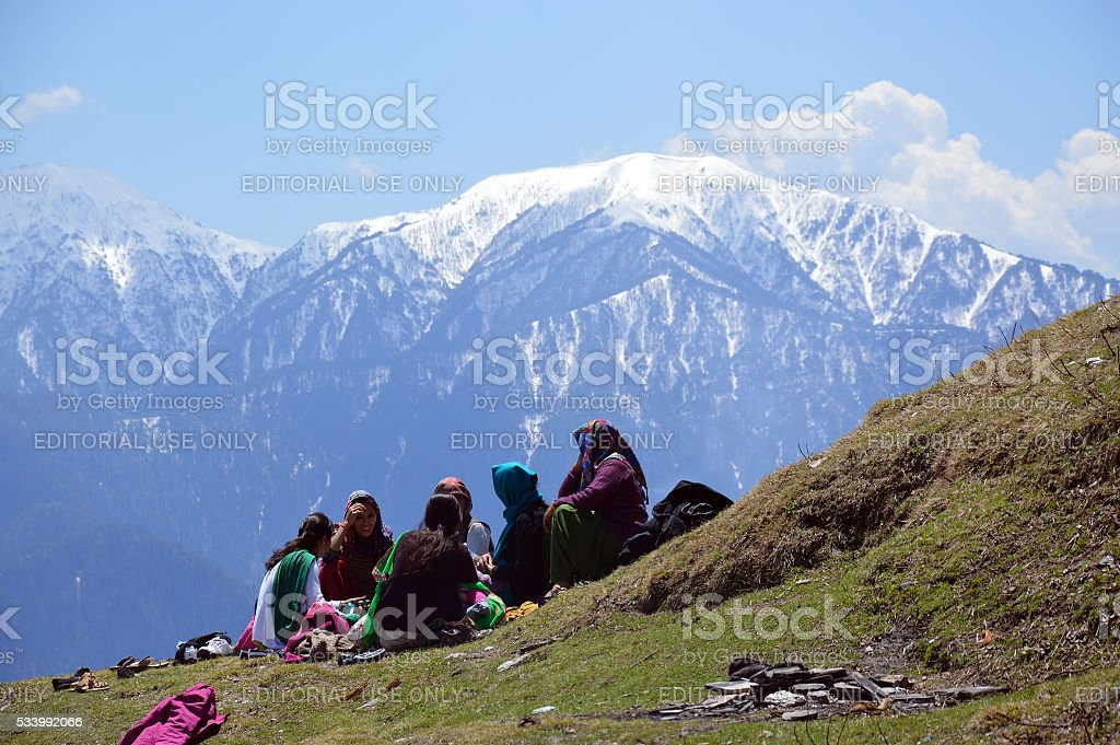 Ladies chatting on a hill top stock photo