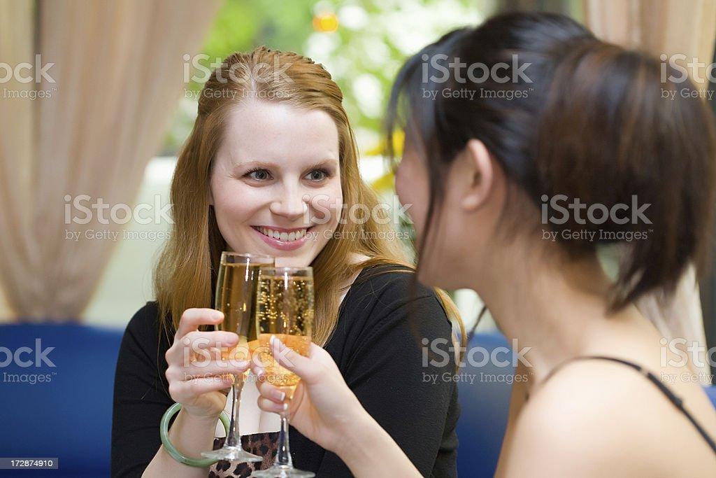 Ladies cheers with champagne royalty-free stock photo