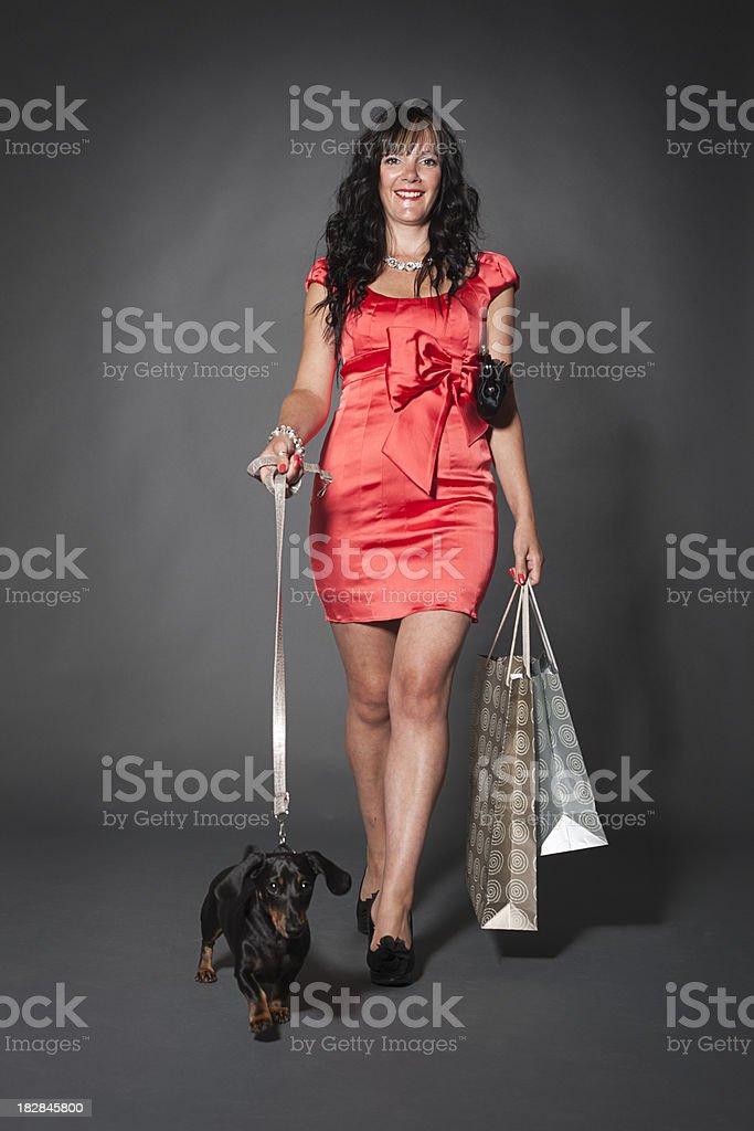 ladies day: walking the dog stock photo