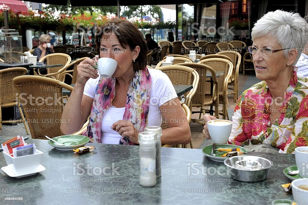 Ladies enjoying a cup of coffee royalty-free stock photo