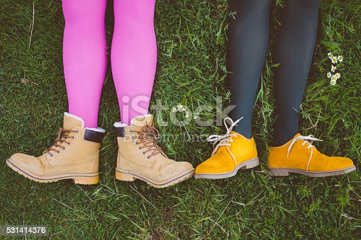 istock Ladies' feet in stylish shoes in bright green grass 531414376