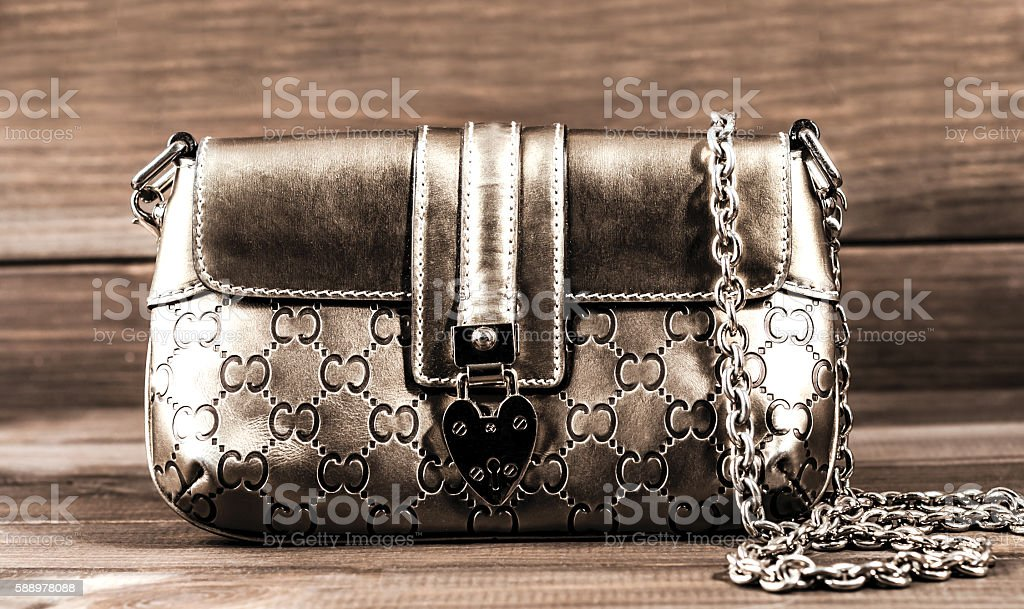 ladies handbag with a chain of genuine leather stock photo
