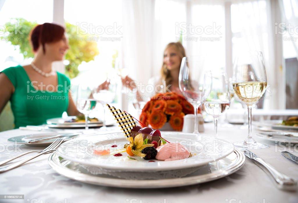 Ladies Having Dessert After Dinner stock photo