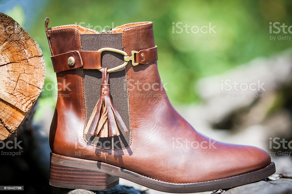 Ladies low heel brown leather ankle boots stock photo