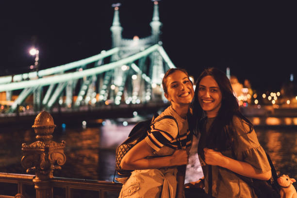 Ladies' night in Budapest Two girls hanging out in Budapest during the summer liberty bridge budapest stock pictures, royalty-free photos & images