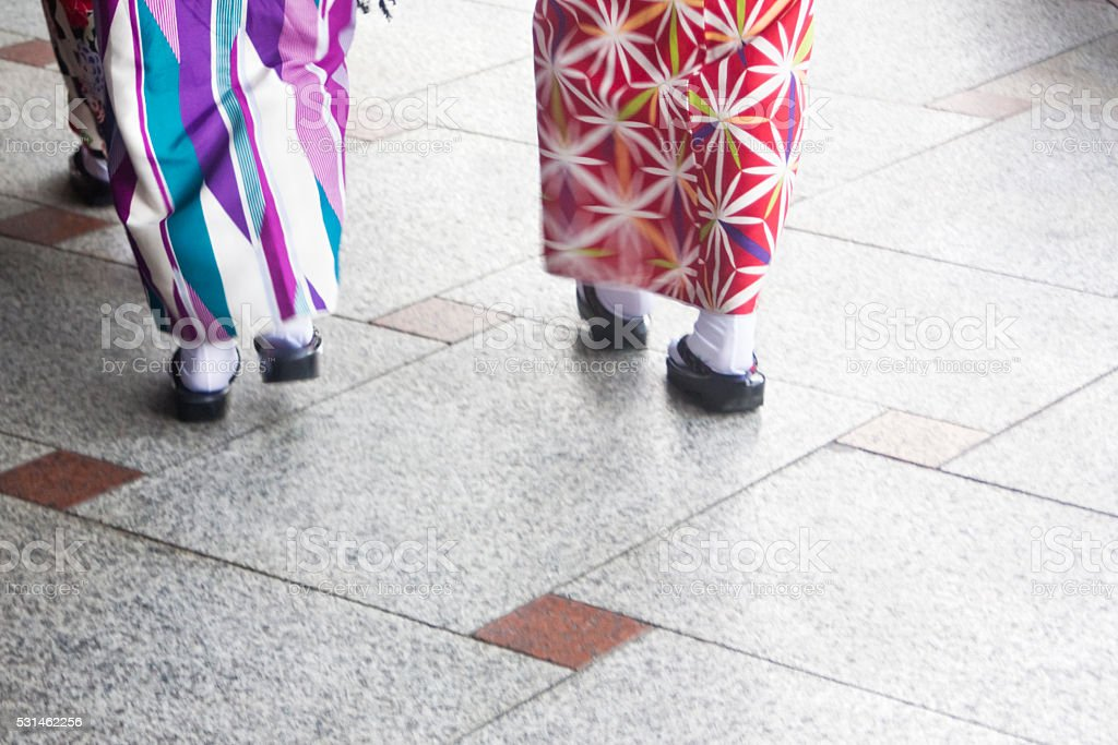 Ladies wearing kimono, walking on the street. stock photo
