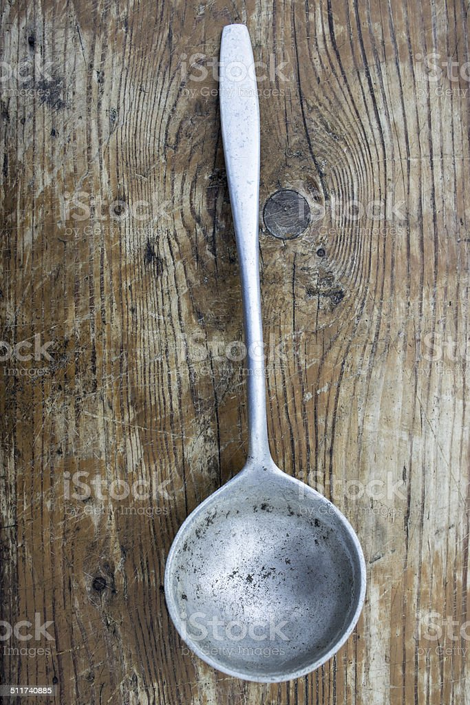 ladle on a wooden background stock photo