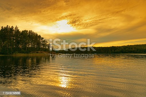 Ladoga Lake at sunset. Bright red and yellow color clouds of sky. Travel to Russia. Leningrad region.