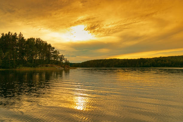 Ladoga Lake at sunset. Bright red and yellow color clouds of sky. Travel to Russia. Leningrad region. Ladoga Lake at sunset. Bright red and yellow color clouds of sky. Travel to Russia. Leningrad region. republic of karelia russia stock pictures, royalty-free photos & images