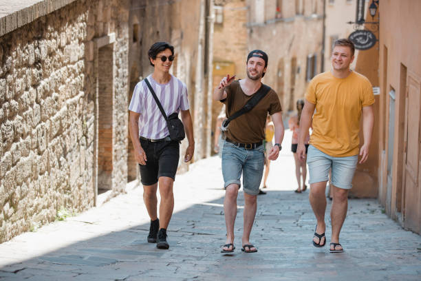 lads exploring volterra - stag night stock pictures, royalty-free photos & images