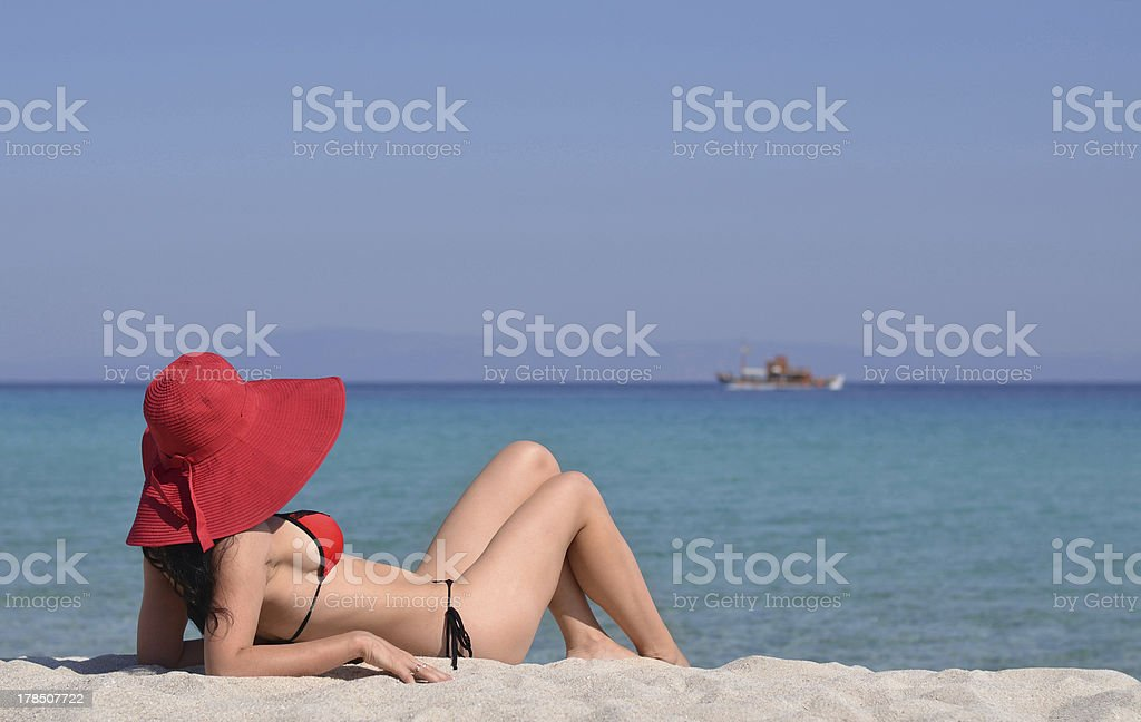 Lady and a boat royalty-free stock photo