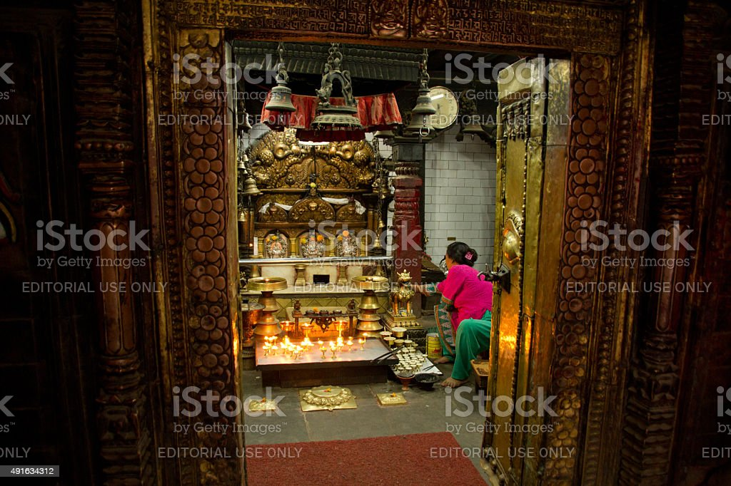Lady and blessings, Kathmandu, Nepal stock photo